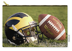 Wolverine Helmet With Football On The Field Carry-all Pouch