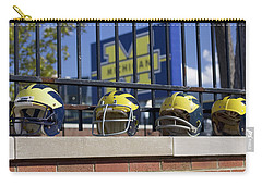 Wolverine Helmets Of Different Eras On Stadium Wall Carry-all Pouch