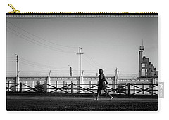 Carry-all Pouch featuring the photograph Woman Walking In Industry by John Williams