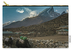 Carry-all Pouch featuring the photograph Yaks Moving Through Dingboche by Mike Reid