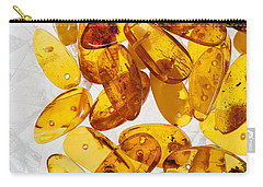 Carry-all Pouch featuring the photograph Yellow Amber Stones  by Andrey  Godyaykin