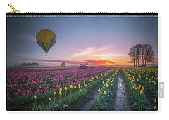 Carry-all Pouch featuring the photograph Yellow Hot Air Balloon Over Tulip Field In The Morning Tranquili by William Lee