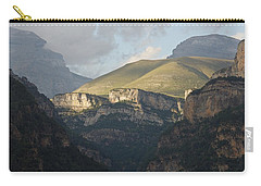 Carry-all Pouch featuring the photograph A Dash Of Light In The Canyon Anisclo by Stephen Taylor