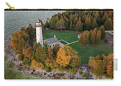 Carry-all Pouch featuring the photograph Cana Island Lighthouse At Dawn by Adam Romanowicz