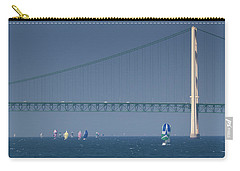 Carry-all Pouch featuring the photograph Chicago To Mackinac Yacht Race Sailboats With Mackinac Bridge by Rick Veldman