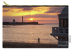 Carry-all Pouch featuring the photograph Couple At Sunset In La Caleta Cadiz Spain by Pablo Avanzini