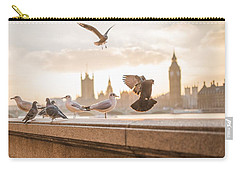 Carry-all Pouch featuring the photograph Doves And Seagulls Over The Thames In London by Top Wallpapers