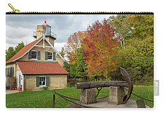 Carry-all Pouch featuring the photograph Eagle Bluff Lighthouse by Adam Romanowicz