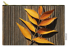 Carry-all Pouch featuring the photograph Golden Autumn Leaves On Wood by Debi Dalio