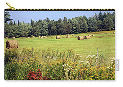 Carry-all Pouch featuring the photograph Hay Bails And Wild Flowers by Tatiana Travelways