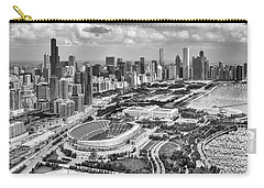 Carry-all Pouch featuring the photograph Soldier Field And Chicago Skyline Black And White by Adam Romanowicz