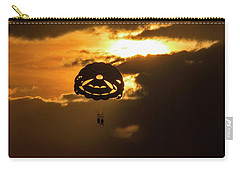 Carry-all Pouch featuring the photograph Sunset Parasailing In Key West by Bob Slitzan