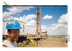 Carry-all Pouch featuring the photograph The Gas Man by Carl Young