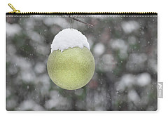 Carry-all Pouch featuring the photograph Yellow Christmas Ball Outside, Covered By Snow. Outside Snowy Wi by Cristina Stefan