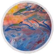 Soaring Dolphins Round Beach Towel by Meryl Goudey