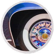 Round Beach Towel featuring the photograph 1962 Ghia L6.5 Coupe Wheel Emblem by Jill Reger