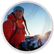 A Woman Backcountry Skiing Round Beach Towel