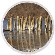 Round Beach Towel featuring the photograph Frozen Pilings by Michael Porchik