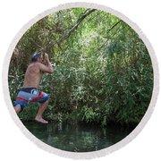 Mature Man Swings From Tree On Rope Round Beach Towel