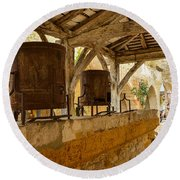 Round Beach Towel featuring the photograph monpazier en Perigord by Dany Lison