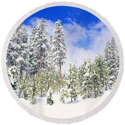 Pine Trees On A Snow Covered Hill Round Beach Towel