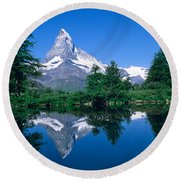 Reflection Of A Snow Covered Mountain Round Beach Towel