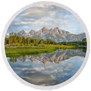Teton Range Reflected In The Snake River Round Beach Towel