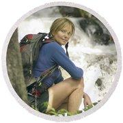 Woman Hiking Along A Creek Round Beach Towel