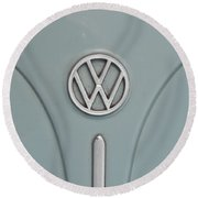 Round Beach Towel featuring the photograph 1965 Volkswagen Beetle Hood Emblem by Jani Freimann