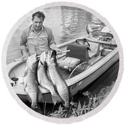 1970s Man In Small Motorboat At Edge Round Beach Towel