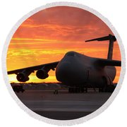 Round Beach Towel featuring the photograph A C-5 Galaxy Sits On The Flightline by Celestial Images