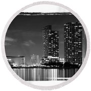 Round Beach Towel featuring the photograph American Airlines Arena And Condominiums by Carsten Reisinger