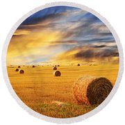 Golden Sunset Over Farm Field With Hay Bales Round Beach Towel