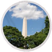 Obelisk Rises Into The Clouds Round Beach Towel