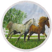 Two Horses Running By White Picket Fence Round Beach Towel