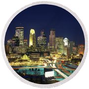 Round Beach Towel featuring the photograph Buildings Lit Up At Night In A City by Panoramic Images