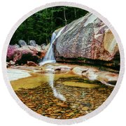 Water Falling From Rocks In A Forest Round Beach Towel