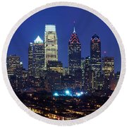 Buildings Lit Up At Night In A City Round Beach Towel