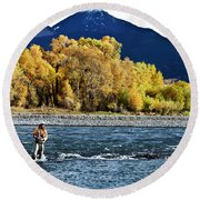 A Athletic Man Fly Fishing Stands Round Beach Towel
