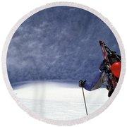 A Backcountry Skier Climbs Round Beach Towel