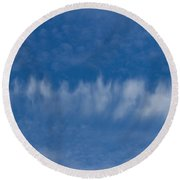 Round Beach Towel featuring the photograph A Batch Of Interesting Clouds In A Blue Sky by Eti Reid