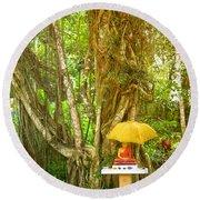 a Buddha shrine under a Bothi tree Round Beach Towel