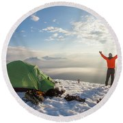 A Camper Lifts His Hand In The Air Round Beach Towel