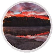 A Christmas Eve Sunrise Round Beach Towel