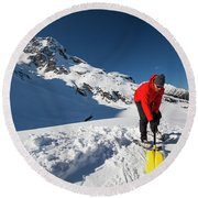 A Climber Shovels Snow In Order To Make Round Beach Towel