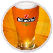 A Cold Refreshing Pint Of Heineken Lager Round Beach Towel