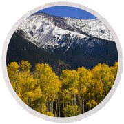 A Dusting Of Snow On The Peaks Round Beach Towel by Saija  Lehtonen