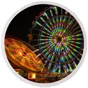 Round Beach Towel featuring the photograph Colorful Carnival Ferris Wheel Ride At Night by Jerry Cowart