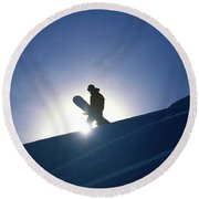 A Female Snowboarder Hiking Round Beach Towel