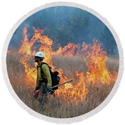 A Firefighter Ignites The Norbeck Prescribed Fire. Round Beach Towel